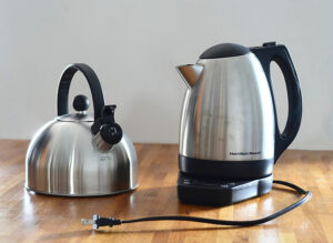 Two electric kettles on brown table